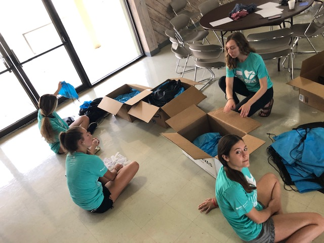 Interact kids prepare care packages for the homeless of Delray Beach
